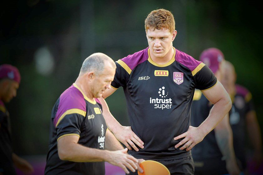 Dylan Napa listens to The Axe, Trevor Gillmeister, a fearsome Maroons defender and now part of the coaching team.