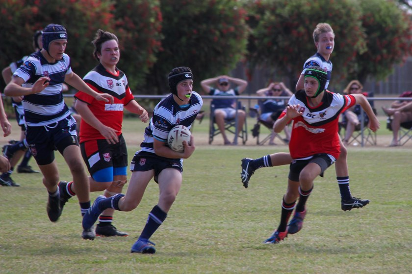 Brothers halfback Ezekiel Monckton evades the Wests defence in their under 15 semi-final clash on Sunday.