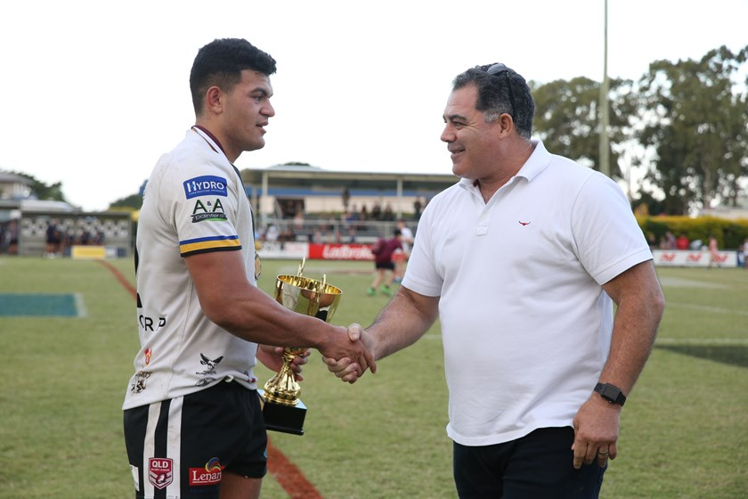 Mal Meninga presents Souths Logan captain David Fifita the Cup after the Magpies won the grand final.