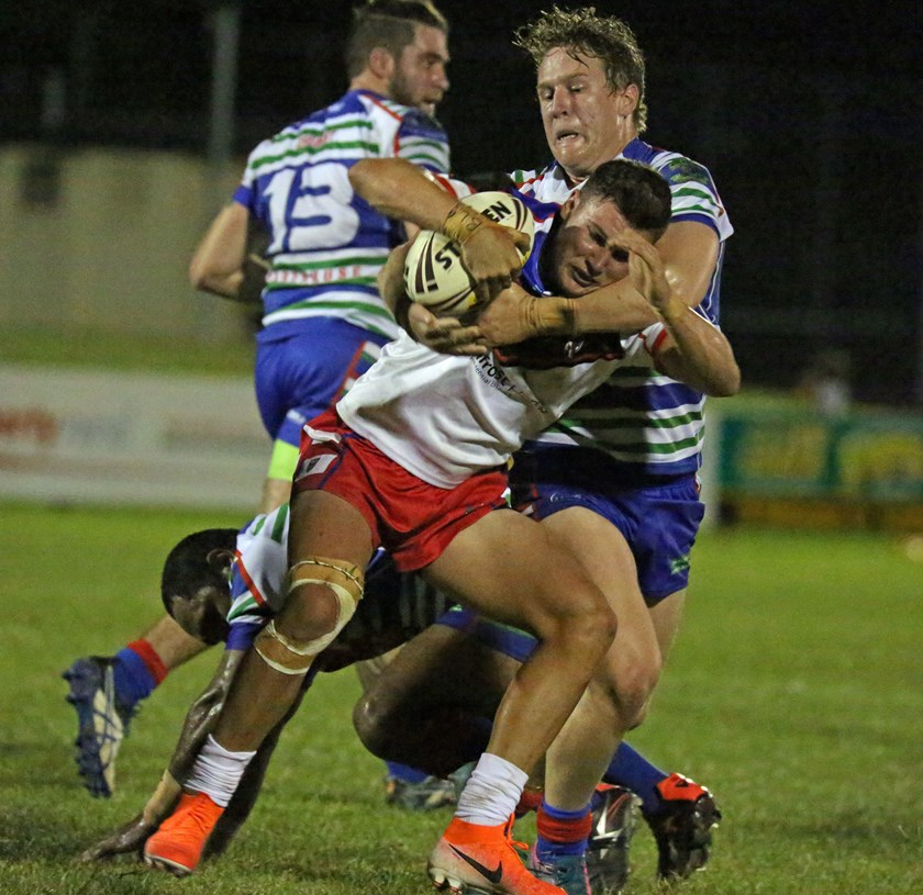 Ivanhoes try scorer Rhy Young is collared by Innisfail's Hugh Sedger. Photo: Maria Girgenti