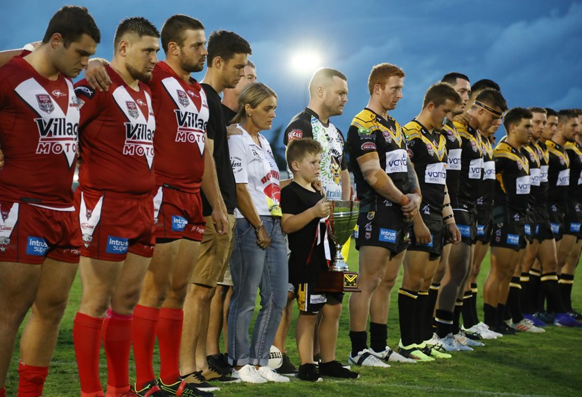 The Ackerman family, with both teams, before the game. Photo: QRL Media