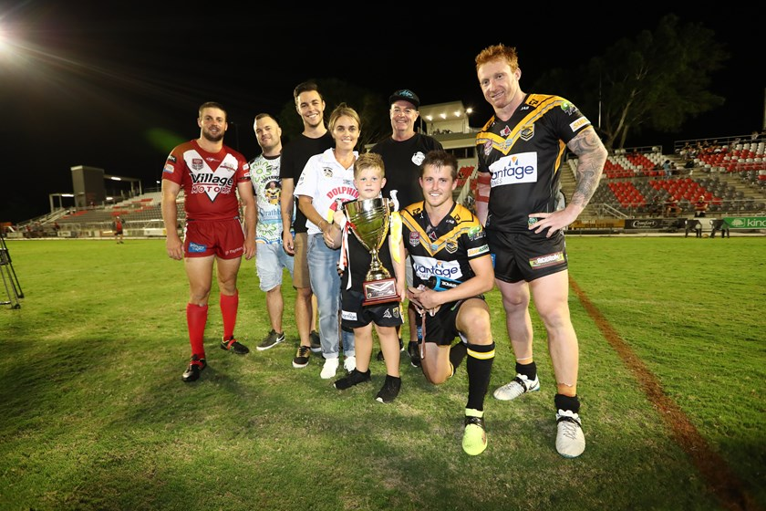 Olliver Ackerman and Todd 'Uncle Toddy' Murphy, with the Ackerman family and both team captains. Photo: QRL Media