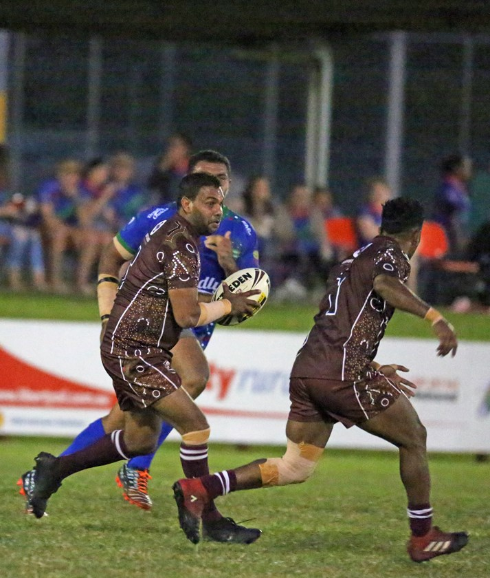 Yarrabah's Fenton Murgha makes a run with the ball and looks to team mate Andrew Garrett Jnr for support. Photo: Maria Girgenti