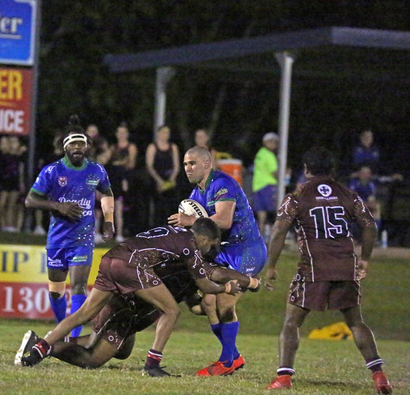 Innisfail player Chris Galea feels the brunt of a two man Yarrabah tackle. Photo: Maria Girgenti