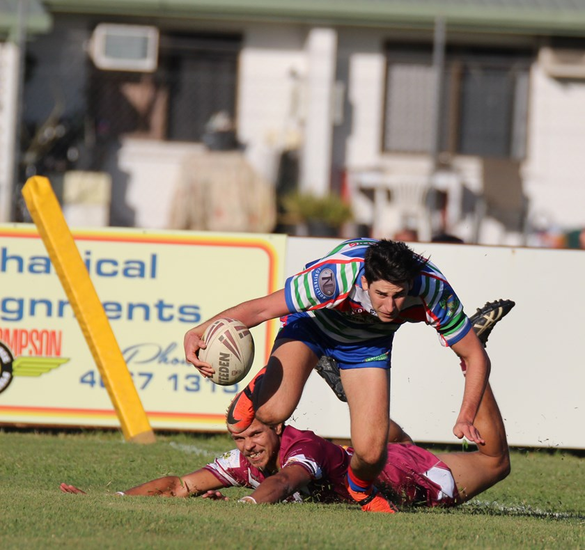 Ashton Galea beats a Yarrabah player and crosses over for Innisfail's first try in the Reserve grade game. Photo: Maria Girgenti