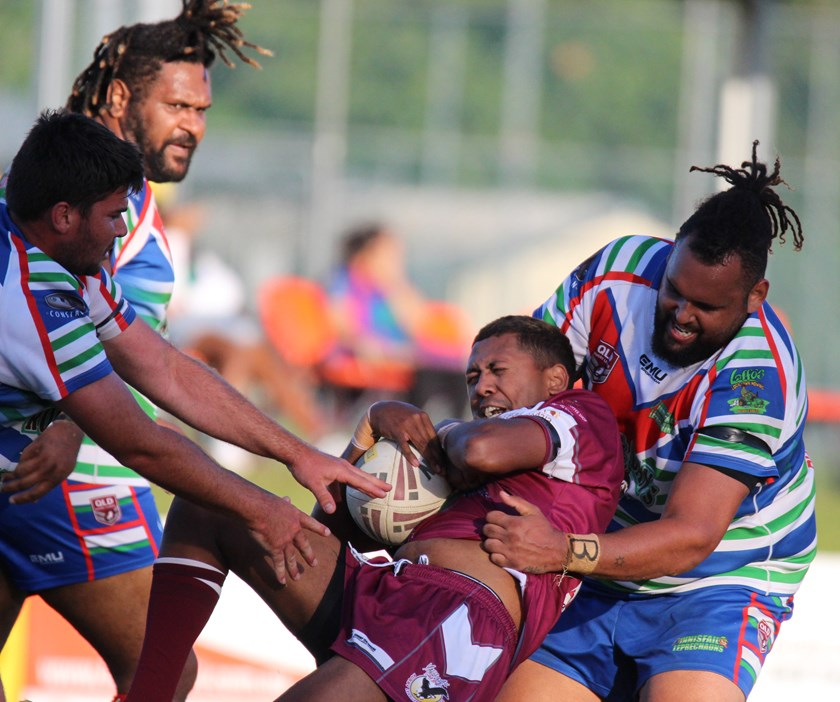 In Reserve grade Innisfail's Kyle Kris brings to ground a Yarrabah player. Photo: Maria Girgenti