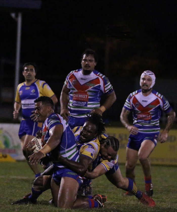 Innisfail's Lata Fakalelu proved difficult for Kangaroos players Bazie Jacko and Matthew Aurich to bring down Photo: Maria Girgenti