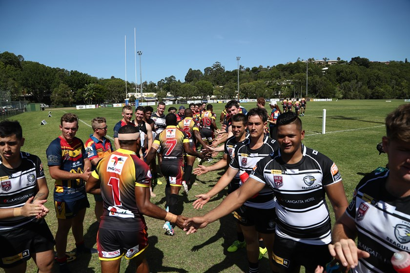 Young Western Mustangs and Tweed Heads Seagulls players show good sportsmanship. Photo: QRL Media