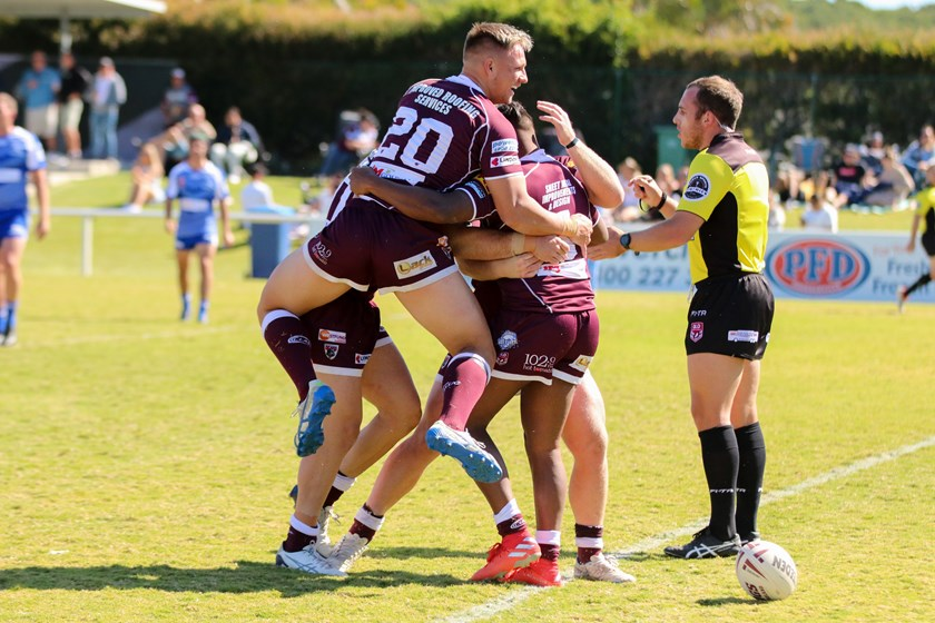 Tristan Powell celebrates with his Burleigh Bears team mates in the Gold Coast A Grade competition. Photo: Cameron Stallard / QRL