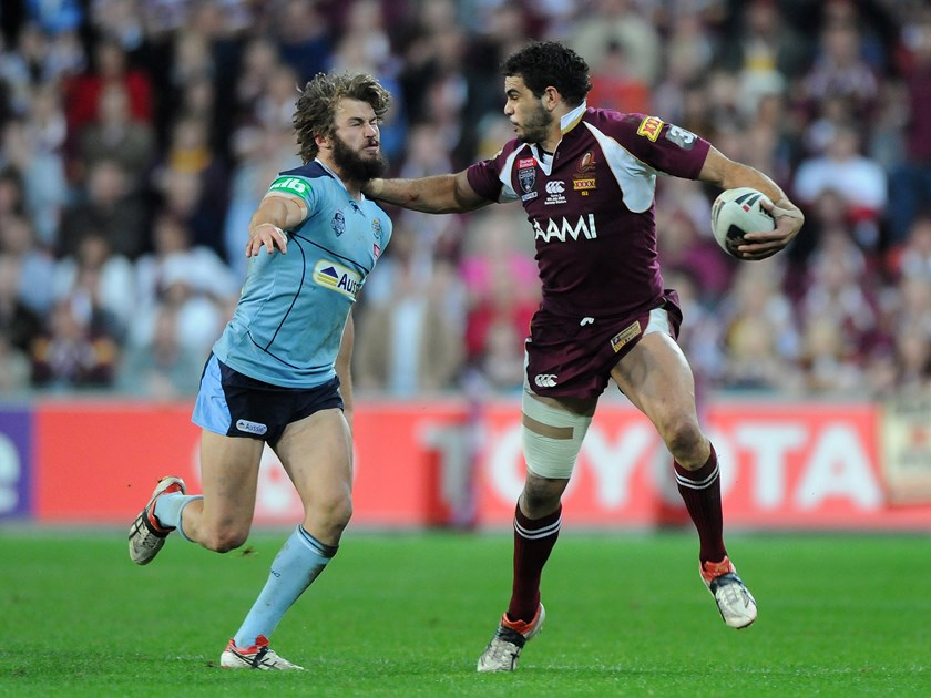Greg Inglis and his famous fend. Photo: QRL Media