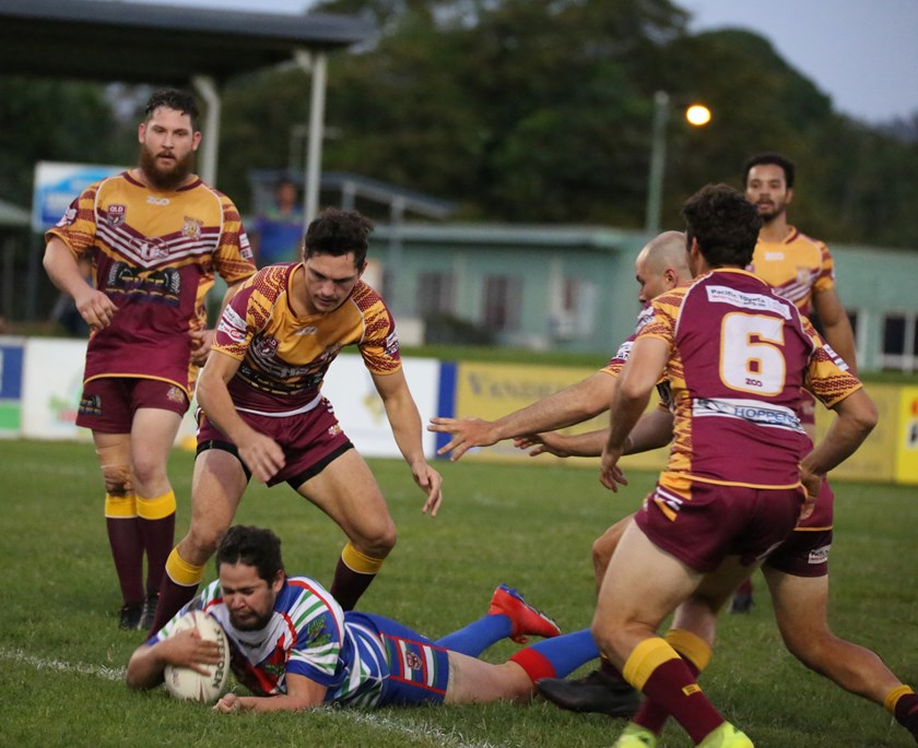 Innisfail's Johann Turner beat the Suburbs defence and crashed over for the first try of the match. Photo: Maria Girgenti