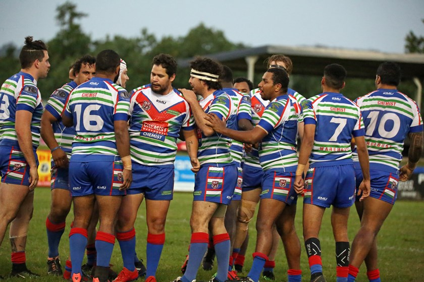 Innisfail players congratulate Johann Turner after he scored the first try of the match. Photo: Maria Girgenti