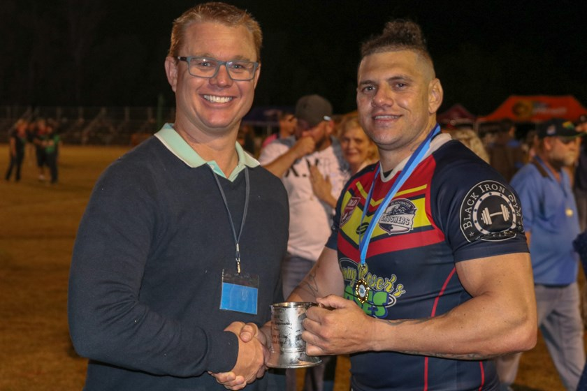Purcell's Engineering Men's player of the final Josh Tanner with QRL Central Region Manager Glenn Ottaway.
