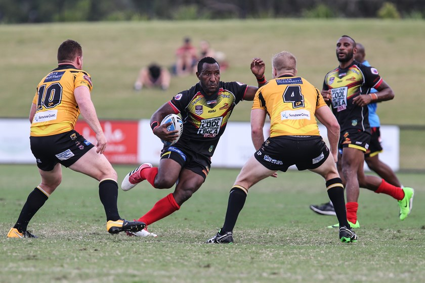 Willie Minoga with the ball for the PNG Hunters. Photo: QRL Media