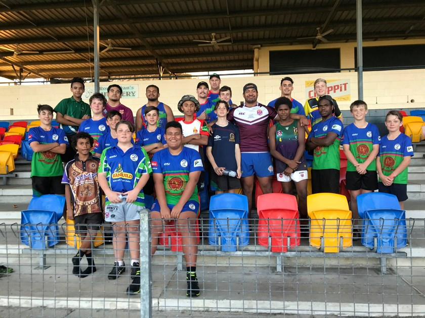 Innisfail Leprechauns coach Leon Hallie and A grade players Lata Fakalelu, Lachlan Biondi-Odo, Aaron Jolley, Joel Lokotui and Elia Mooka with Innisfail Leprechauns Under 13s players.