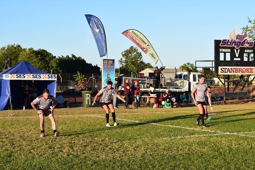 Marcus Schooth, Peter MacKinnon, James Harbidge and Tim Rutherford warm up at John Henry Memorial Oval, Normanton. Photo: QRL Media
