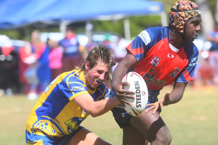 Atherton's Zaimen Gilbert is tackled by a Malanda player in the Under 14 grand final and was the winner of the Top Try Scorer award. Photo: Darryl Day