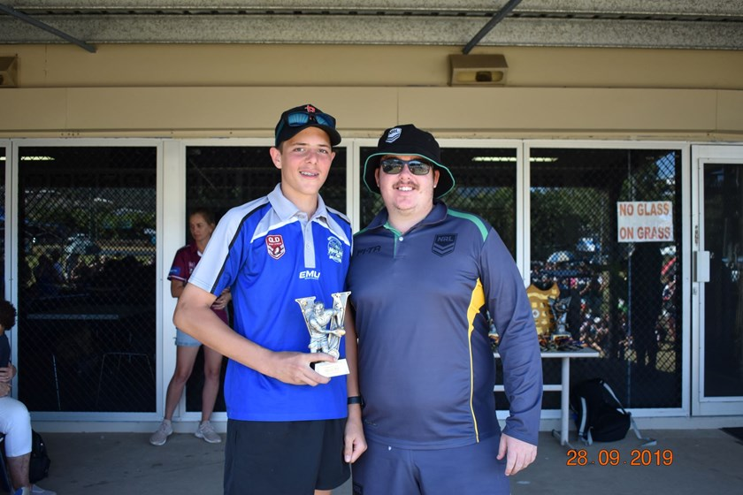 Referee of the Carnival Alex Reid from Mackay with Jaymi Evans.
