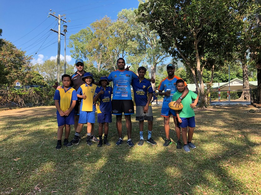 Northern Pride Under 20 coach Dave Scott and Pride players Terrence Casey-Douglas and Teddy Anson with White Rock State School students at the school's NAIDOC Week celebrations.