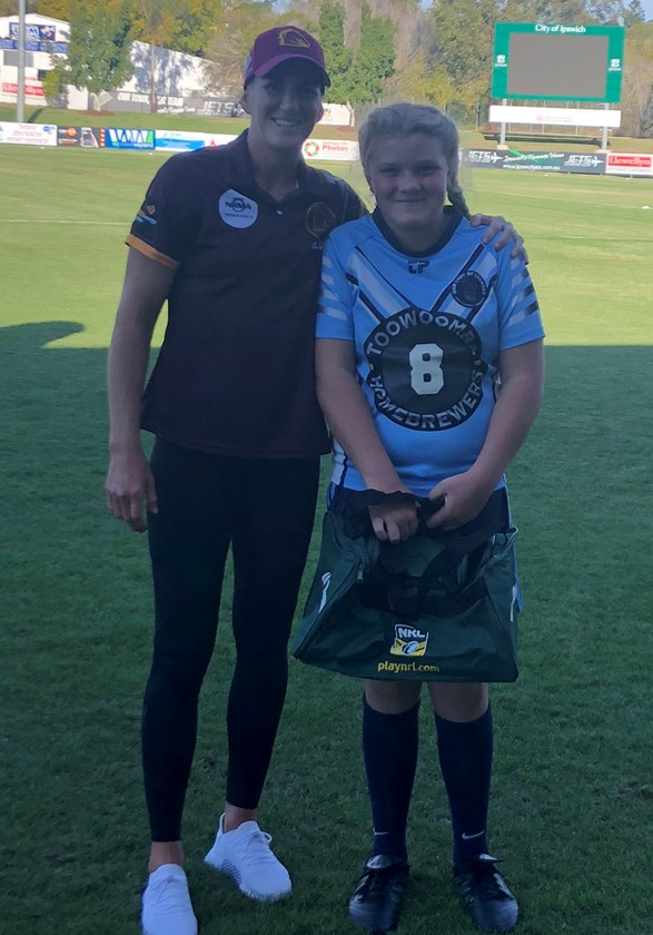 Our Lady of Lourdes player Jessica Watt with Australia, Queensland and Broncos representative player Ali Brigginshaw.  Main Image: Our Lady of Lourdes team with Rachel Salisbury. Submitted Images
