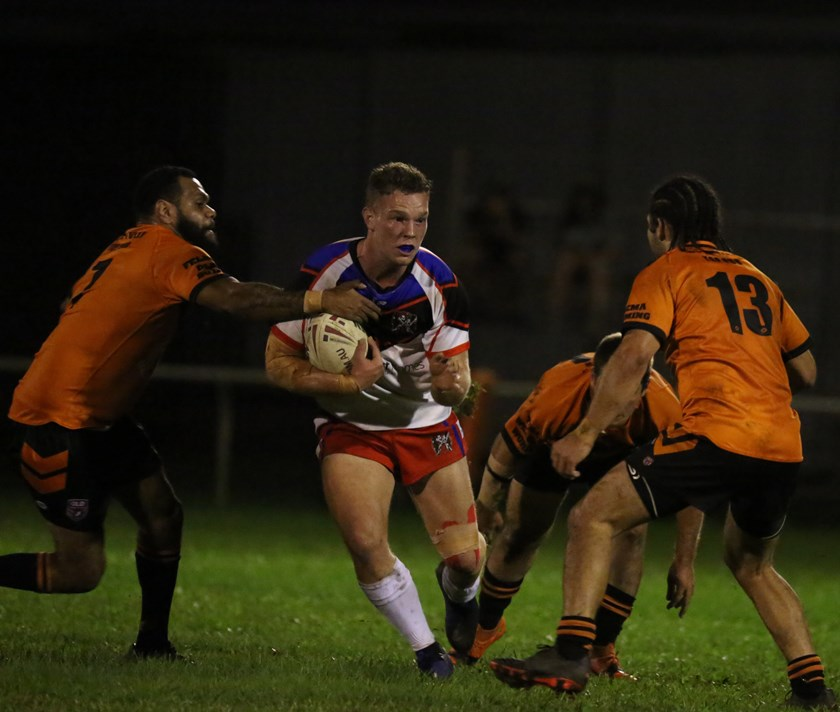 Ivanhoes first try scorer Dallas Skardon looks for space to run up the middle of the Tully defence Photo: Maria Girgenti