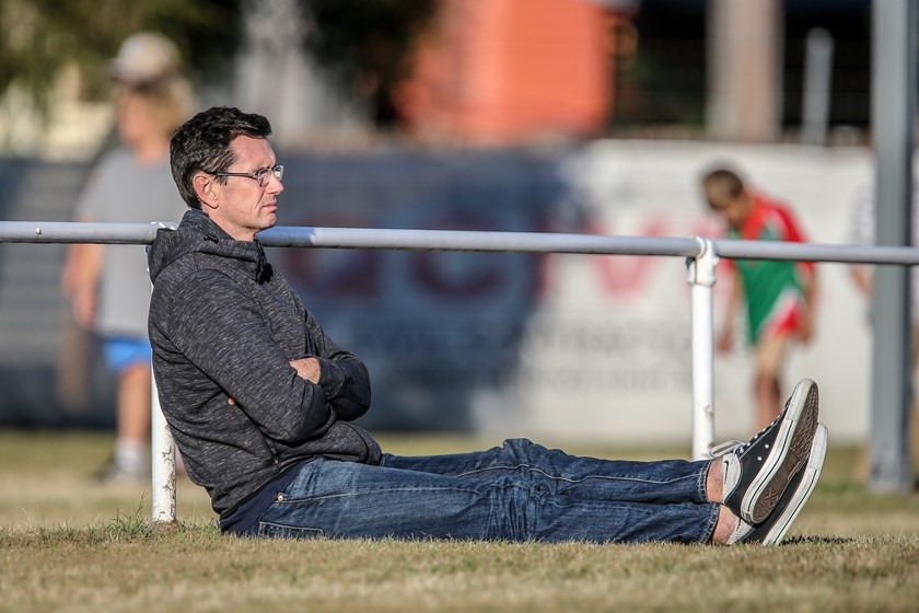 Ben Ikin watches an Intrust Super Cup game during Country Week. Photo: Ritchie Duce QRL Media