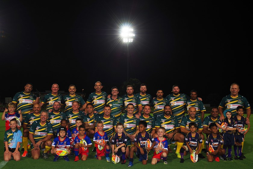 Australian Legends of League team with Cairns District Junior Rugby League Under 6 players. Photo: Maria Girgenti