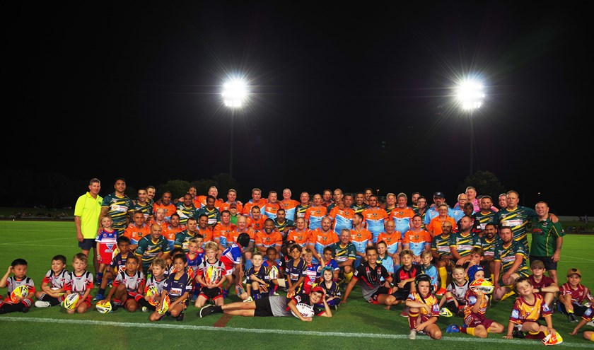 Australian Legends of League and FNQ All Stars teams with future stars of the game - Cairns District Junior Rugby League Under 6 players. Photo: Maria Girgenti