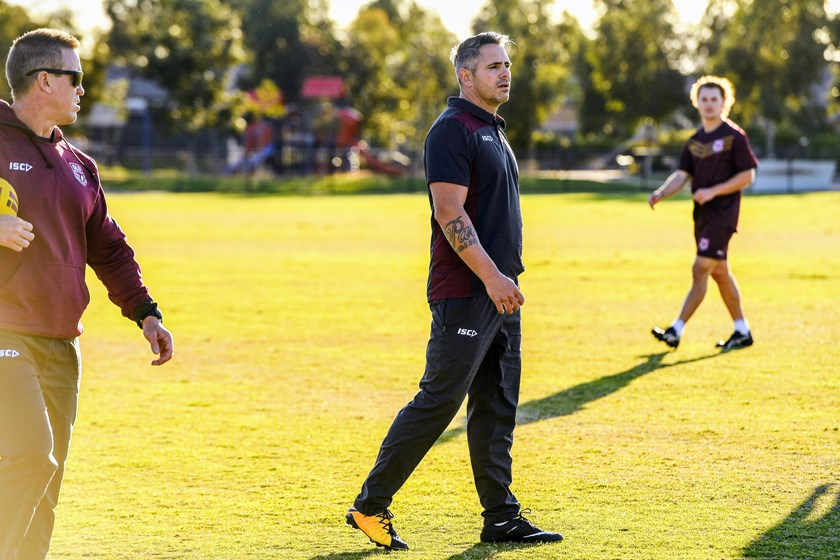 Retired Maroons prop Corey Parker helps out at camp.