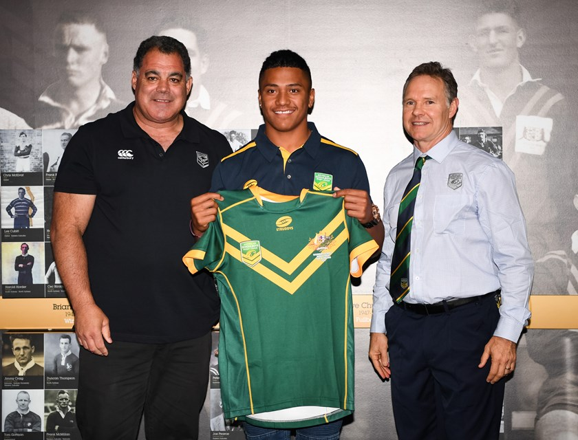 Souths Logan Magpies and Marsden SHS player Tesi Niu was presented with his Australian Schoolboys jersey by Kangaroos coach Mal Meninga. Photo: NRL Images