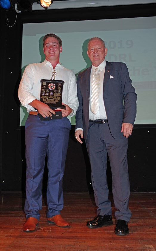 Will Kennedy won the Referee of the Year and was awarded the Curtis Pitt MP Trophy by Warren Pitt. Photo: Maria Girgenti