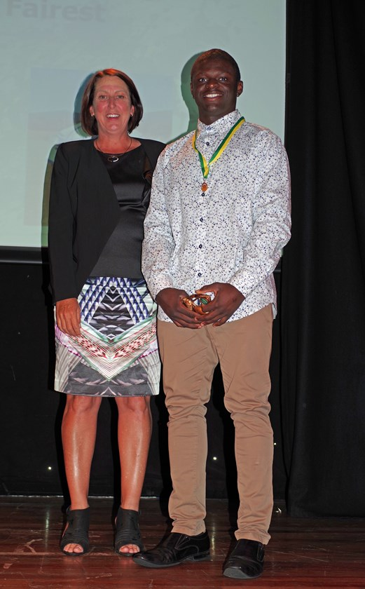 Saifu Savage from Cairns Brothers won the Cairns District Rugby League Under 16 Best & Fairest Silver Medal which was presented to him by Jodi Stevens - Cairns District Junior Rugby League Chairman. Photo: Maria Girgenti