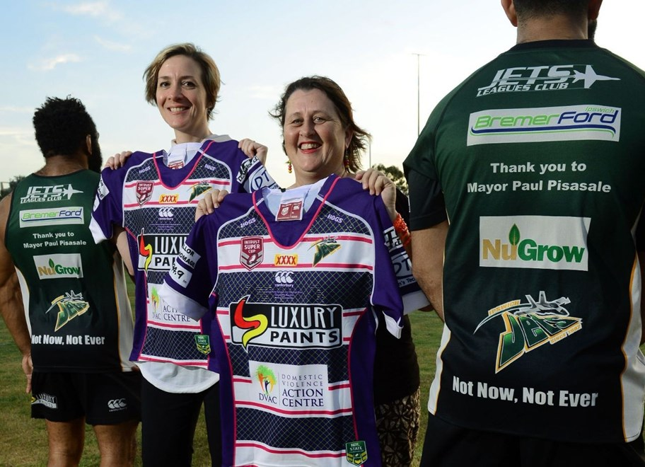 The Ipswich Jets rugby league club are supporting the Not Now, Not Ever anti domestic violence campaign. Domestic Violence Action Centre general manager Gabrielle Borggaard and community development worker Heather Ellis with Jets players.